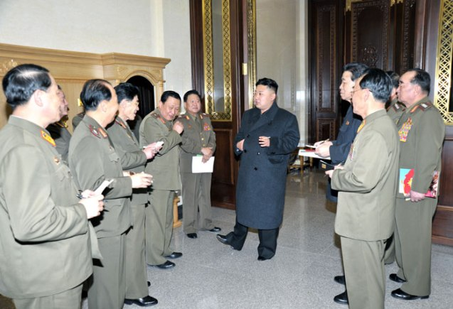 Kim Jong Un (C) talks with senior KPA officials and commanders after watching a rehearsal by the KPA Song and Dance Ensemble in Pyongyang on 24 March 2013 (Photo: Rodong Sinmun)