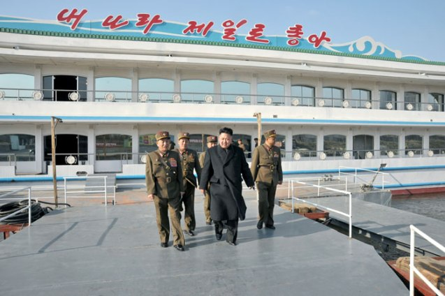 Kim Jong Un (2nd L) tours a Taedonggang restaurant boat on 24 March 2013.  Also seen in attendance is Gen. Kim Yong Chol (L) (Photo: Rodong Sinmun)