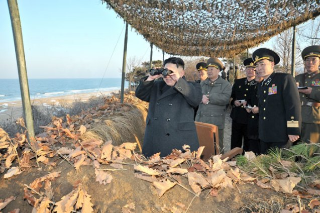 Kim Jong Un observes live fire joint exercises by DPRK ground, naval and artillery forces on the country's east coast on 25 March 2013 (Photo: Rodong Sinmun)