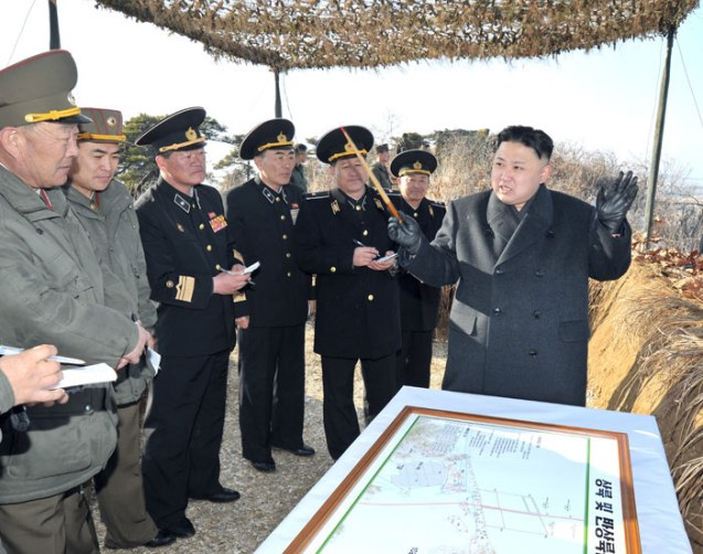 Kim Jong Un reviews an operations plan during joint live exercises on the country's east coast on 25 March 2013.  Also seen in attendance is Chief of the KPA General Staff, Gen. Hyon Yong Chol (L) (Photo: Rodong Sinmun)