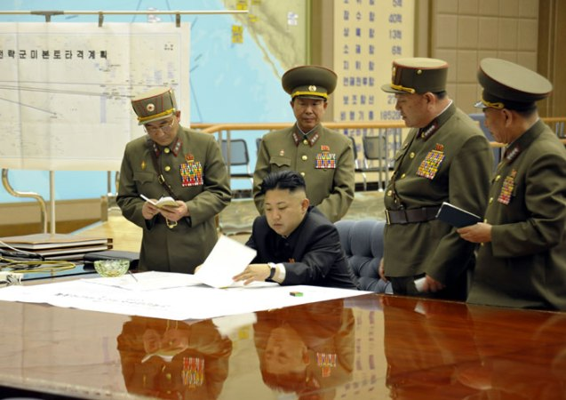 "Kim Jong Un (seated) reviews military operations plans, prior to ordering the DPRK's missiles and strategic rockets to be ""on stand-by.""  Behind him (L-R) are Lt. Gen. Kim Rak Gyom (Commander of the KPA Strategic Rocket Force Command), Col. Gen. Ri Yong Gil (Chief of the KPA General Staff Operations Bureau), Gen. Hyon Yong Chol (Chief of the KPA General Staff) and Gen. Kim Yong Chol (Chief of the Reconnaissance General Bureau and Vide Chief of the KPA General Staff) (Photo: Rodong Sinmun)"
