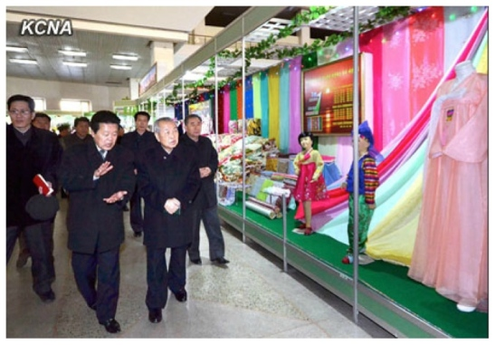 DPRK Premier Choe Yong Rim (foreground, R) tours an exhibition of light industry goods at the Three Revolutions Exhibition in Pyongyang (Photo: KCNA)