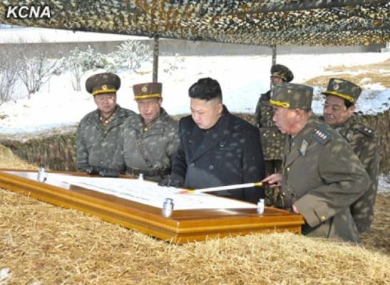 Gen. Ri Pyong Chol (R), commander of the KPA Air and Anti-Air Forces, briefs Kim Jong Un (2nd R) about live fire anti-aircraft drills (Photo: KCNA)