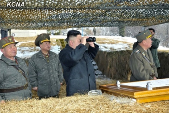 Kim Jong Un (3rd L) observes anti-aircraft drills through binoculars.  Also seen in attendance are VMar Choe Ryong Hae (2nd L) and Gen. Ri Pyong Chol (R) (Photo: KCNA)