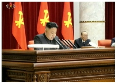 Kim Jong Un speaks at a meeting of the KWP Central Committee, held in Pyongyang on 31 March 2013.  Seen sitting behind him (R) is SPA Presidium Vice President Yang Hyong Sop (Photo: KCTV screengrab)