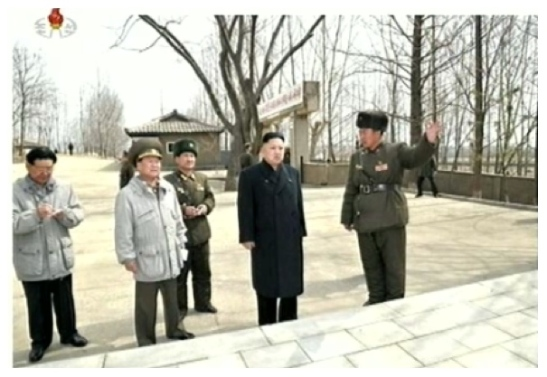 Kim Jong Un is briefed on a historical monument marking a 2003 visit by his father Kim Jong Il to the command element of KPA Unit #1973.  Also seen in attendance is Hwang Pyong So (L) and VMar Choe Ryong Hae (2nd L) (Photo: KCTV screengrabs)