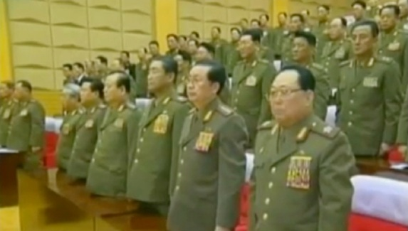 CMC members stand during the 2012 meeting.  In the front row in this image are VMar Kim Yong Chun (R), Jang Song Taek (2nd R), VMar Kim Jong Gak (3rd R), Pak To Chun (4th R), Choe Ryong Hae (5th R) and Ju Kyu Chang (6th R) (Photos: KCTV screengrabs)