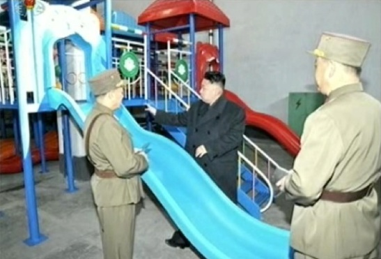 Kim Jong Un inspects a playground slide produced by KPA Unit #1501 on 25 March 2013 (Photo: KCTV screengrab)