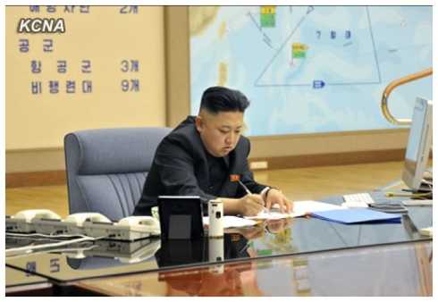 Kim Jong Un signs military orders on 29 March 2013 (Photo: KCNA)