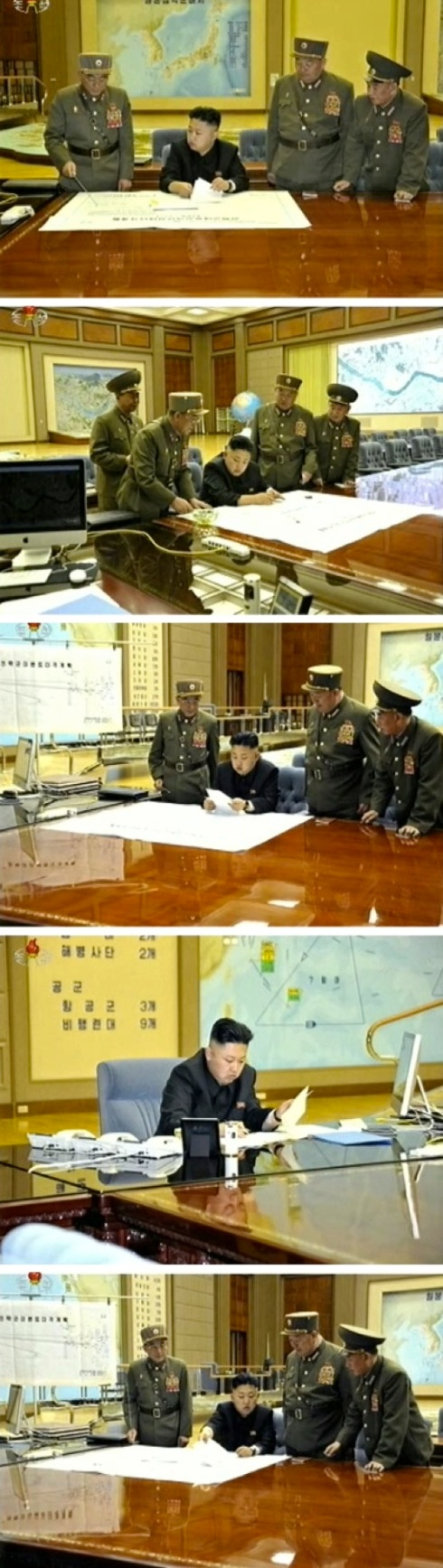 Kim Jong Un participates in an operational planning meeting on 29 March 2013.  Briefing KJU in these images is Lt. Gen. Kim Rak Gyom (L), commander of the KPA Strategic Rocket Force Command (Photos: KCTV screengrabs)