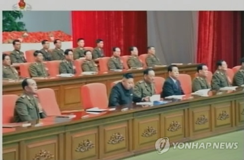 Kim Jong Un (2nd L, front row) attends a meeting of KPA information officers at the 25 April House of Culture in Pyongyang on 28 March 2013.  Also seen in attendance in the front row are Gen. Kim Kyok Sik (L), Gen. Hyon Yong Chol (3rd L) and Kim Kyong Ok (4th L) (Photo KCTV-Yonhap)
