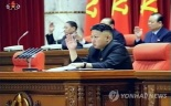 Kim Jong Un raises his right hand at the start of the KWP Central Committee plenary meeting in Pyongyang on 31 March 2013.  Also seen in attendance on the platform (rostrum) behind KJU are DPRK Cabinet Vice Premier Kang Sok Ju (L) and KWP Secretary Pak To Chun (R).  (Photo: KCTV-Yonhap)