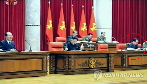 Kim Jong Un (C) reads through the meeting documents of the Korean Workers Party Central Committee plenary meeting on 31 March 2013.  Also seen in the front row are SPA Presidium President Kim Yong Nam (L) and (highlighted) NDC Vice Chairman and KWP Administration Director Jang Song Taek (R) (Photo: KCTV-Yonhap)