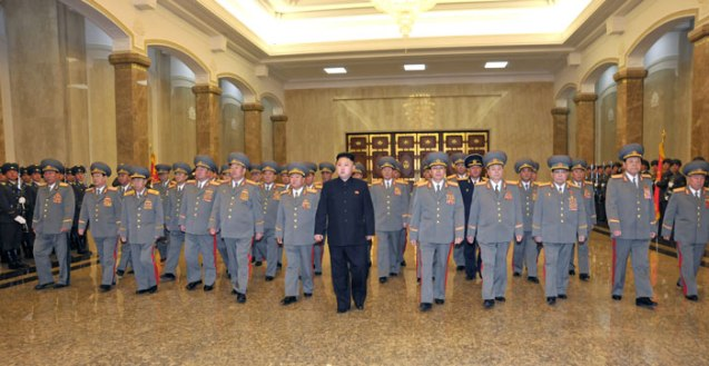 Kim Jong Un (7th L) and members of the Party Central Military Commission and DPRK National Defense Commission visit Kumsusan Palace of the Sun in Pyong at midnight on 15 April 2013 on the 101st anniversary of the birth of his paternal grandfather the late DPRK President and founder Kim Il Sung (Photo: Rodong Sinmun)