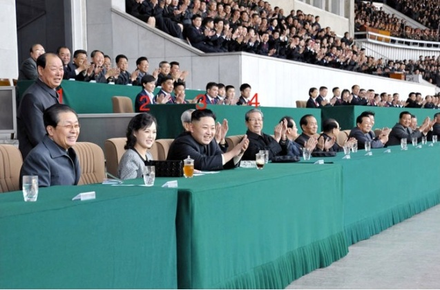 Kim Jong Un (3) attends the men's premier league football finals for the Mangyongdae Prize at Kim Il Sung Stadium in Pyongyang on 29 April 2013.  Also watching the game with are Jang Song Taek (1), Ri Sol Ju (2) and Choe Tae Bok) (Photo: Rodong Sinmun)