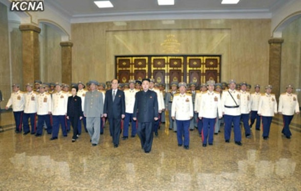 Kim Jong Un (8th L) and senior members of the DPRK's national security community pay their respects to statues of Kim Il Sung and Kim Jong Il at the Ku'msusan Memorial Palace in Pyongyang on 25 April 2013, the official 81st anniversary of the foundation of the Korean People's Army.(Photo: KCNA)