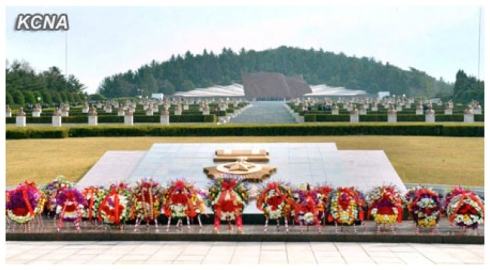 Floral wreaths placed in front of a monument and memorial stones at the Revolutionary Martyrs' Cemetery in Pyongyang to mark the official foundation of the country's military (Photo: KCNA)