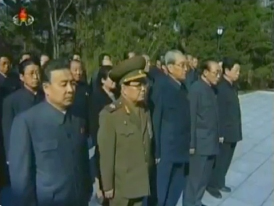 Members of the DPRK's central leadership attend a wreath-laying ceremony at Kang Pan Sok's grave in Pyongyang on 22 April 2013  In attendance at the graveside ceremony are Mun Kyong Dok (L), VMar Kim Yong Chun (2nd L), Kim Ki Nam (3rd L), Yang Hyong Sop (4th L) and Ro Ru Chol (5th L) (Photos: KCTV screengrabs)