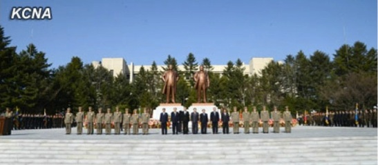 Members of the DPRK central leadership and senior MPS officials attend a dedication ceremony of Kim Il Sung and Kim Jong Il at MPS Headquarters in Pyongyang on 14 April 2013 (Photo: KCNA)