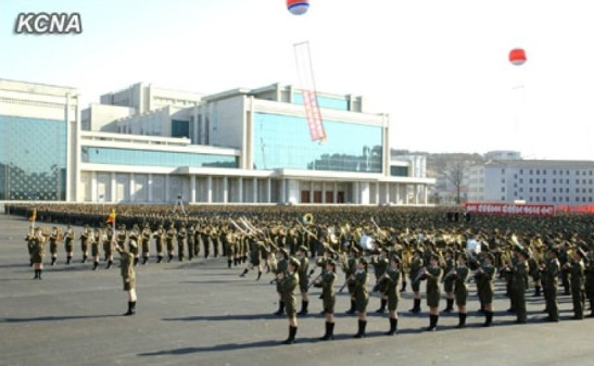 The all-woman brass band of the Korean People's Internal Security Forces play a musical programme during the 14 April 2013 unveiling ceremony.  In the background is the Ponghwa Art Theater.  (Photo: KCNA)