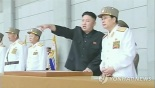 Kim Jong Un (2nd R) points to something at an event held at the plaza in front of Ku'msusan Memorial Palace in Pyongyang on 25 April 2013 to mark the KPA's official 81st anniversary.  KJU is seen talking to his uncle, Jang Song Taek (R), Vice Chairman of the DPRK National Defense Commission and Director of the KWP Administration Department.  (Photo: KCTV-Yonhap)
