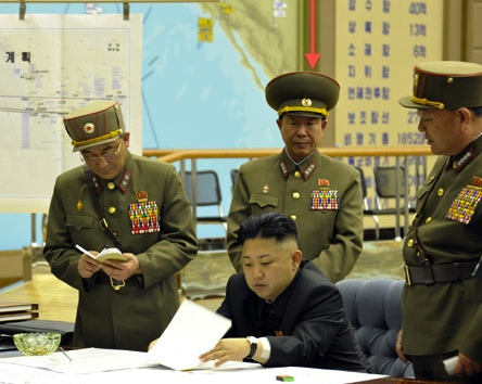Col. Gen. Ri Yong Gil (annotated) attends a 29 March 2013 meeting at which Kim Jong Un was briefed upon and authorized the use of missile units against US and ROK military bases (Photo: Rodong Sinmun)