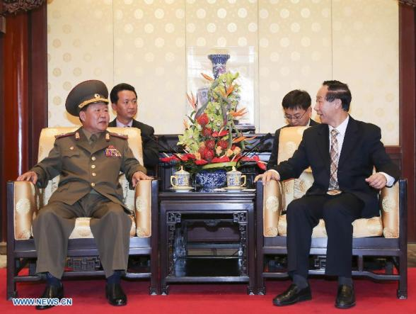 Wang Jiarui (R), vice-chairman of the National Committee of the Chinese People's Political Consultative Conference and head of the International Department of the Communist Party of China Central Committee, meets with Choe Ryong Hae, special envoy of the Democratic People's Republic of Korea (DPRK) top leader Kim Jong Un, and a member of the Presidium of the Political Bureau of the Central Committee of the Workers' Party of Korea, in Beijing, capital of China, May 22, 2013. (Xinhua/Ding Lin)