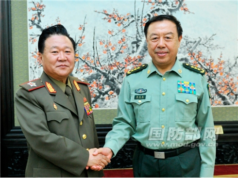 VMar Choe Ryong Hae (L), Director of the  KPA General Political Department and Vice Chairman of the KWP Central Military Commission, shakes hands with Gen. Fan Changlong (R), Vice Chairman of the CPC Central Military Commission in Beijing on 24 May 2013 (Photo: PRC MOD)