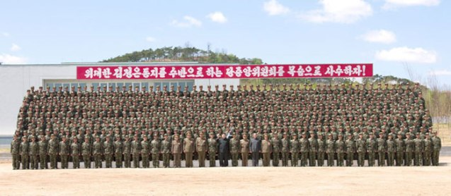 Kim Jong Un poses for a commemorative photograph with officers and service members of Korean People's Internal Security Forces Unit #2219 on 1 May 2013 (Photo: Rodong Sinmun)