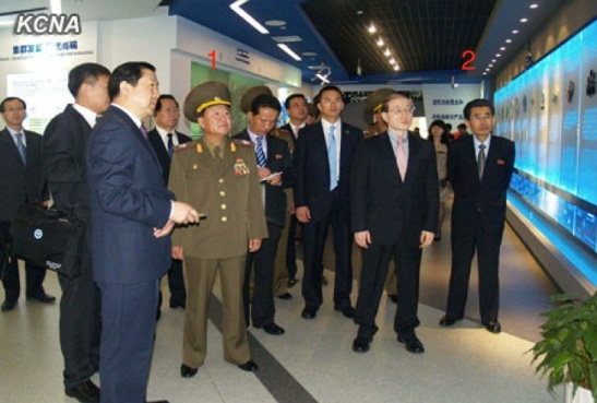 Choe Ryong Hae (1) tours the Beijing Economic and Technological Development Park.  Also in attendance is Kim Song Nam (2), Deputy Director of the KWP International Affairs Department (Photo: KCNA).