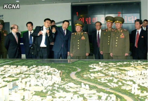 VMar Choe Ryong Hae (1), special envoy of Kim Jong Un, views a scale model of Beijing Economic and Technological Development Park.  Also in attendance is Col. Gen. Gen. Ri Yong Gil (2), chief of the KPA General Staff Operations Bureau (Photo: KCNA).