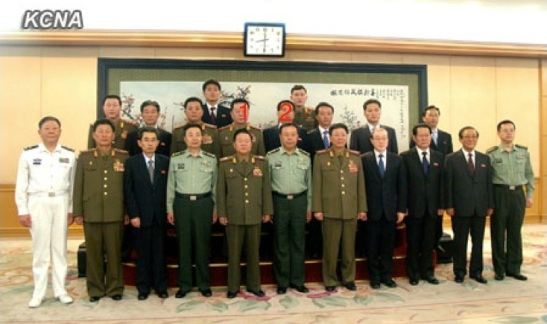 VMar Choe Ryong Hae (1)  and a senior DPRK delegation pose for a commemorative photograph with CPC Central Military Commission Vice Chairman Gen. Fan Changlong (2) and senior PLA officials in Beijing on 24 May 2013 (Photo: KCNA)