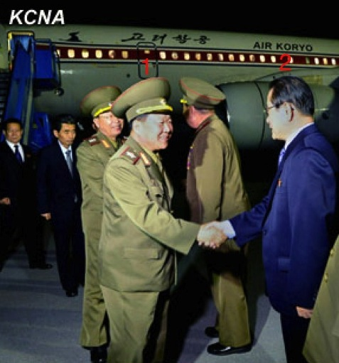 VMar Choe Ryong Hae (1) shakes hands with Kim Yong Il (2), Korean Workers' Party Secretary and Director of the International Affairs Department, after arriving at Pyongyang Airport on 24 May 2013 from a three day visit to China (Photo: KCNA).