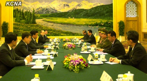 VMar Choe Ryong Hae and a senior-level DPRK delegation (R) meet with Liu Yunshan and senior CPC officials in Beijing on 23 May 2013 (Photo: KCNA)