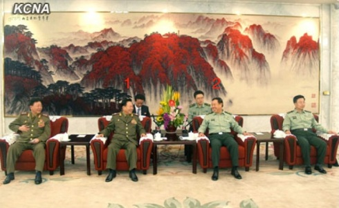 VMar Choe Ryong Hae (1), a special envoy of DPRK leader Kim Jong Un, talks with Gen. Fan Changlong (2), Vice Chairman of the CPC Central Military Commission during a meeting in Beijing on 24 May 2013 (Photo: KCNA)