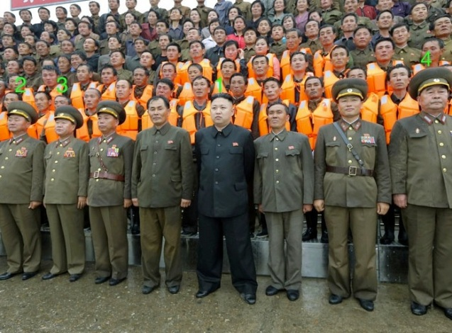 Kim Jong Un (1) poses for a commemorative photograph with managers and employees of the 25 August Fishery Station of KPA Unit #313.  Also seen in attendance is Minister of the People's Armed Forces Gen. Jang Jong Nam (2), Director of the KPA General Political Department VMar Choe Ryong Hae (3) and Chief of the KPA General Staff Gen. Kim Kyok Sik (4) (Photo: Rodong Sinmun).