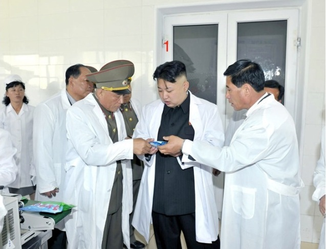 Kim Jong Un (1) learns about a product during a visit to the foodstuffs factory under KPA Unit #634 (Photo: Rodong Sinmun).