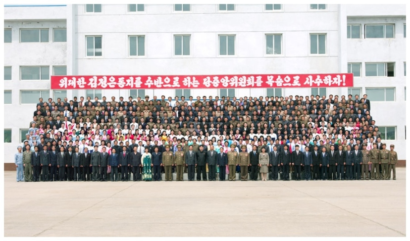 Kim Jong Un poses for a commemorative photograph after touring a foodstuffs factory under KPA Unit 534 (Photo: Rodong Sinmun).