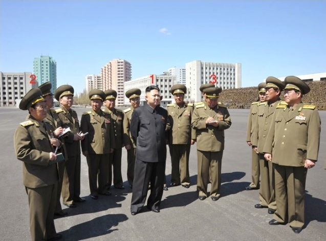 Kim Jong Un (1) on the plaza in front of the Ministry of People's Security headquarters in Pyongyang, prior to commemorative photo-ops on May Day (1 May) in Pyongyang.  Also in attendance are Minister of People's Security, Col. Gen. Choe Pu Il (3) and Director of the KPSIF Political Bureau, Col. Gen. Ri Pyong Sam (2) (Photo: Rodong Sinmun)