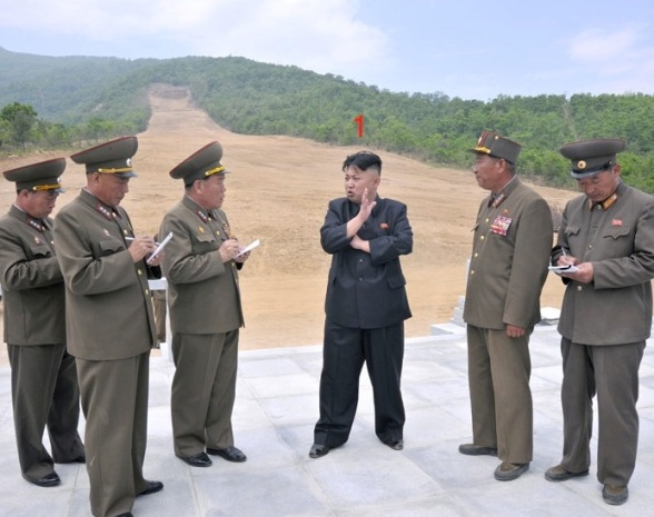 Kim Jong Un stands at the bottom of a ski slope during his visit to the construction of the Masik Pass Ski Park in Kangwo'n Province (Photo: Rodong Sinmun).