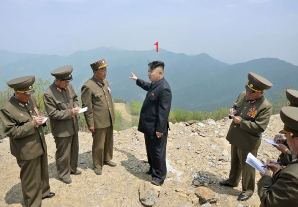 Kim Jong Un (1) talks with senior officials and KPA construction managers on a peak at the construction site of the Masik Pass Ski Park in Kangwo'n Province (Photo: Rodong Sinmun).