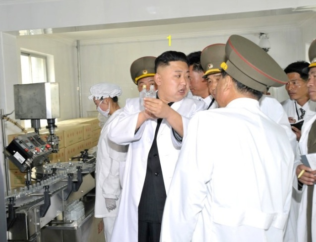 Kim Jong Un (1) tours the production line at Ryongmun Liquor Factory. (Photo: Rodong Sinmun)