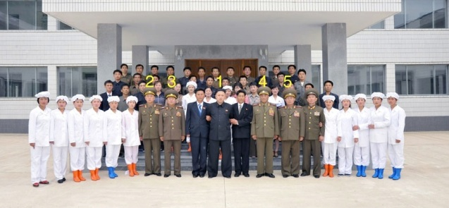Kim Jong Un (1) poses for a commemorative photograph with managers and employees of the Ryongmun Liquor Factory.  Also in attendance are Lt. Gen. Pak Jong Chon (2), VMar Choe Ryong Hae (3), Col. Gen. Jon Chang Bok (4) and Col. Gen. So Hong Chang (5).  (Photo: Rodong Sinmun)