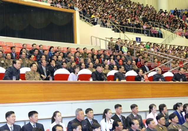 Kim Jong Un (1) watches a sports competition of public health workers on 1 May 2013 with his wife Ri Sol Ju (2).  Also in attendance are: Jang Song Taek (3), VMar Choe Ryong Hae (4), Pak Pong Ju (5), Kim Kyong Hui (6), Kim Ki Nam (7) and Kim Yang Gon (8).  (Photo: Rodong Sinmun)