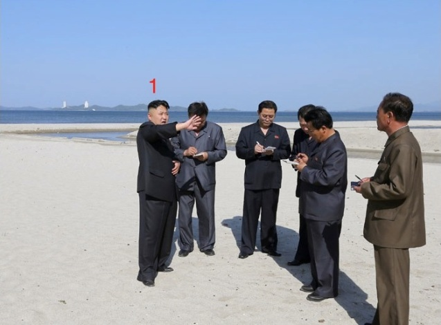 Kim Jong Un (1) issues instructions while touring a beach at Songdowon International Children's Camp in Wo'nsan, Kangwo'n Province on the DPRK's east coast (Photo: Rodong Sinmun)