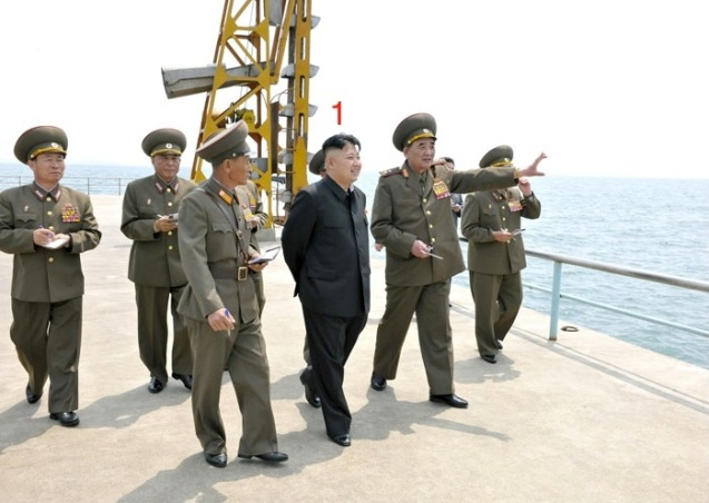 "Kim Jong Un (1) tours a dock at the ""supply base"" of KPA Unit #639 (Photo: Rodong Sinmun)"