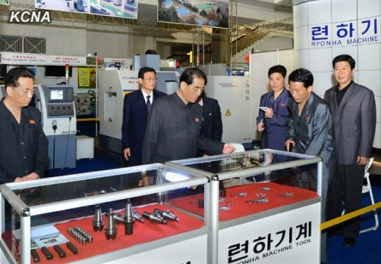 DPRK Cabinet Premier Pak Pong Ju (1) is briefed about the Ryonha Machinery Company's exhibition at the 16th annual Pyongyang Spring International Trade Fair at the Three Revolutions Exhibition in Pyongyang. (Photo: KCNA)