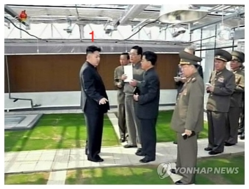 Kim Jong Un (1) talks with managers of the Turf Institute of the State Academy of Sciences during a visit there.  (Photo: KCNA-Yonhap)