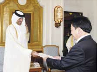 Qatar's Heir Apparent and Deputy Emir, HH Sheikh Tamim bin Hamad al-Thani (L) accepts a letter of credence from DPRK Ambassador So Chang Sik (R) at his Emiri Diwan office on 22 April 2013 (Photo: Emiri Diwan of HH Deputy Emir and Heir Apparent and Gulf Times)