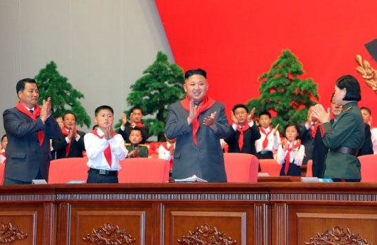 Kim Jong Un (3rd L) applauds during the Korean Children's Union's 7th Congress on 6 June 2013.  Also in attendance is Jon Yong Nam (L), Chairman of the Kim Il Sung Socialist Youth League (Photo: Rodong Sinmun).